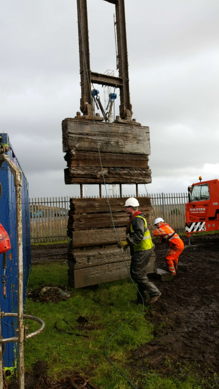 old greenheart sluice paddle being removed